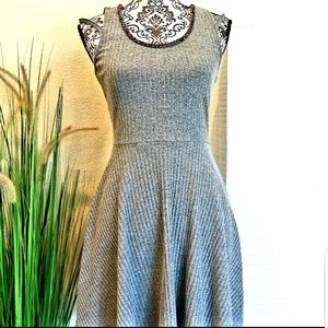 women gray color mini dress with beaded neckline